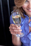 Smiling woman making a toast Royalty Free Stock Photos