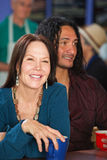 Smiling Woman with Man in Cafe Royalty Free Stock Photos