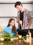 Smiling woman and man cooking Royalty Free Stock Photo