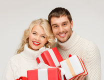Smiling woman and man with gift box Stock Photography