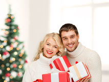 Smiling woman and man with gift box Stock Images