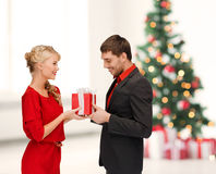 Smiling woman and man with gift box Royalty Free Stock Images