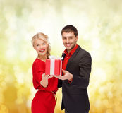 Smiling woman and man with gift box Royalty Free Stock Photos