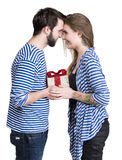 Smiling woman and man with gift box Royalty Free Stock Image