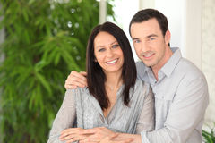 Smiling woman and man hugging Stock Photography
