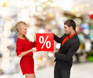 Smiling woman and man with red percent sale sign stock photo