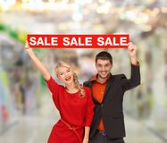 Smiling woman and man with red sale sign Stock Images