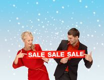Smiling woman and man with red sale sign Stock Photo