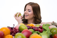 smiling woman with many fruits Royalty Free Stock Photography