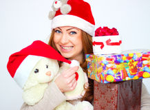 Smiling woman  with many gift boxes Stock Photography