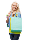 Smiling woman with many shopping bags Stock Photo