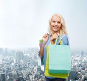 Smiling woman with many shopping bags Stock Image