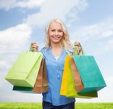 Smiling woman with many shopping bags Stock Images