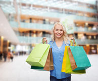 Smiling woman with many shopping bags Stock Photography