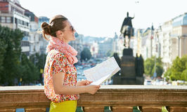 Smiling woman with map standing near National Museum in Prague Royalty Free Stock Photos