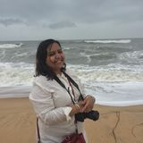 A smiling woman at Maravante Beach with a professional camera. During trip to Kundapura Stock Photography