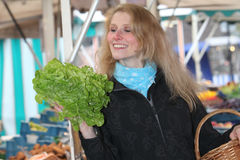 Smiling woman at the market with a salad Stock Photo