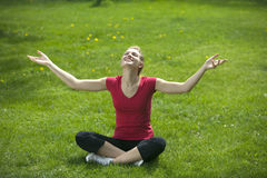 Smiling woman meditating Royalty Free Stock Image