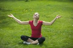 Smiling woman meditating Royalty Free Stock Image