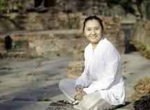 Smiling woman meditating Royalty Free Stock Photos