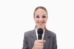 Smiling woman with microphone Stock Photography