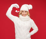 Smiling woman in mittens and hat with jingle bells. Christmas, x-mas, winter, happiness concept - smiling woman in mittens and hat with jingle bells Stock Images