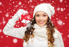 Smiling woman in mittens and hat with jingle bells. Christmas, x-mas, winter, happiness concept - smiling woman in mittens and hat with jingle bells Stock Photography