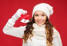Smiling woman in mittens and hat with jingle bells Royalty Free Stock Photos