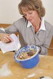 Smiling woman mixing dough Royalty Free Stock Photography