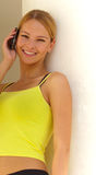 Smiling woman with mobile Stock Image