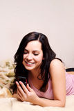 Smiling woman with mobile Royalty Free Stock Photography