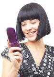 Smiling woman with mobile phone Stock Image
