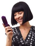 Smiling woman with mobile phone Royalty Free Stock Photography