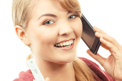 Smiling woman with mobile phone informing someone about positive pregnancy test Royalty Free Stock Image