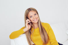 Smiling woman with mobile phone Royalty Free Stock Photos