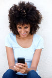 Smiling woman with mobile phone  on white background Stock Photo