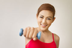 Smiling woman model posing with dumbbell Royalty Free Stock Images