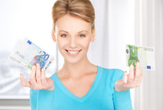 Smiling woman with money Royalty Free Stock Image