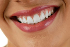 Smiling woman mouth. With great white teeth royalty free stock photography