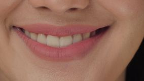 Smiling woman mouth with great white teeth close up
