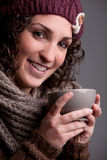 Smiling woman with a mugful of a hot drink Royalty Free Stock Images