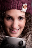 Smiling woman with a mugful of a hot drink Royalty Free Stock Photography