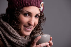 Smiling woman with a mugful of a hot drink Stock Photos