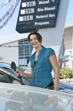 Smiling Woman At Natural Gas Station Stock Images