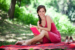 Smiling woman in nature Royalty Free Stock Image