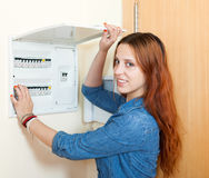 Smiling woman near power control panel Royalty Free Stock Image