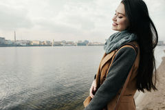 Smiling woman near the river Royalty Free Stock Photography