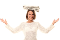 Smiling woman with newspapers on a head Royalty Free Stock Images
