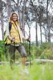 Smiling woman nordic walking Stock Photos