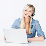 Smiling woman with a notebook and headset stock photos